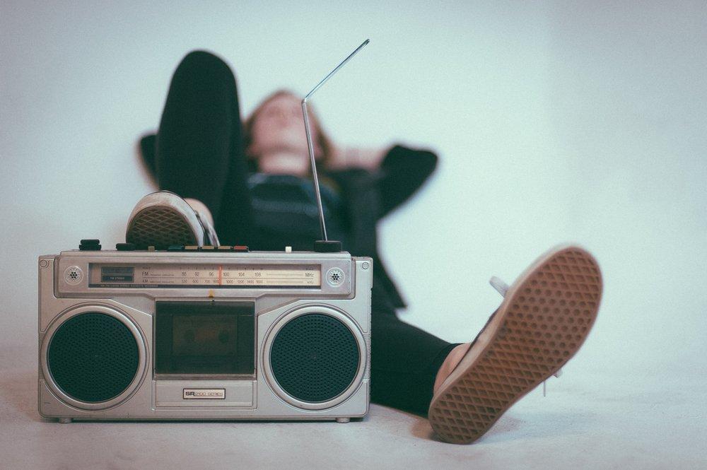 man listening to the radio